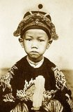 Emperor Duy Tân (Nguyễn Phúc Vĩnh San, 14 August 1899 – 25 December 1945), was a child Emperor of the Nguyễn Dynasty and reigned for nine years between 1907 and 1916. His name was Prince Nguyễn Phúc Vĩnh San and was son of the Thành Thái Emperor. Because of his opposition to French rule and his erratic, depraved actions (which some speculate were feigned to shield his opposition from the French) Thành Thái was declared insane and exiled to Vũng Tàu in 1907.<br/><br/>  The French decided to pass the throne to his son Nguyễn Phúc Vĩnh San, who was only seven years old, because they thought someone so young would be easily influenced and controlled, and could be raised to be pro-French. This proved to be a big mistake on the part of the French. Nguyễn Phúc Vĩnh San was enthroned with the reign name of Duy Tân, meaning 'friend of reform' and in time would prove unwilling to live up to this name. As he became older he noticed that, even though he was treated as the Emperor, it was the colonial authorities who were actually obeyed.<br/><br/>  As he became a teenager, Emperor Duy Tân came under the influence of the mandarin Trần Cao Vân, who was very much opposed to the colonial administration. Emperor Duy Tân began to plan a secret rebellion with Trần Cao Vân and others to overthrow the French. In 1916, while France was preoccupied with fighting World War I, Emperor Duy Tân was smuggled out of the Forbidden City with Trần Cao Vân to call upon the people to rise up against the French.<br/><br/>  However, the secret was revealed and France immediately sent troops, and after only a few days they were betrayed and captured by the French authorities. Because of his age and in order to avoid a worse situation, Emperor Duy Tân was deposed and exiled instead of being killed. Trần Cao Vân and the rest of the revolutionaries were all beheaded.