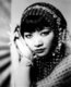 Anna May Wong (January 3, 1905 – February 3, 1961) was an American actress, the first Chinese American movie star, and the first Asian American to become an international star. Her long and varied career spanned both silent and sound film, television, stage, and radio.<br/><br/>  Born near the Chinatown neighborhood of Los Angeles to second-generation Chinese-American parents, Wong became infatuated with the movies and began acting in films at an early age. During the silent film era, she acted in The Toll of the Sea (1922), one of the first movies made in color and Douglas Fairbanks' The Thief of Bagdad (1924). Wong became a fashion icon, and by 1924 had achieved international stardom. Frustrated by the stereotypical supporting roles she reluctantly played in Hollywood, she left for Europe in the late 1920s, where she starred in several notable plays and films, among them Piccadilly (1929). She spent the first half of the 1930s traveling between the United States and Europe for film and stage work.<br/><br/>   Wong was featured in films of the early sound era, such as Daughter of the Dragon (1931) and Daughter of Shanghai (1937), and with Marlene Dietrich in Josef von Sternberg's Shanghai Express (1932). In 1935 Wong was dealt the most severe disappointment of her career, when Metro-Goldwyn-Mayer refused to consider her for the leading role in its film version of Pearl S. Buck's The Good Earth, choosing instead the German actress Luise Rainer to play the leading role. Wong spent the next year touring China, visiting her family's ancestral village and studying Chinese culture.<br/><br/>   In the late 1930s, she starred in several B movies for Paramount Pictures, portraying Chinese-Americans in a positive light. She paid less attention to her film career during World War II, when she devoted her time and money to helping the Chinese cause against Japan. Wong returned to the public eye in the 1950s in several television appearances as well as her own series in 1951, T